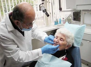 Patient getting dentures fitted
