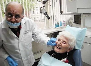 Patient being fitted for dentures